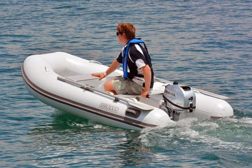 inflatable boat rigged with  honda 4-5-6 hp outboard motor