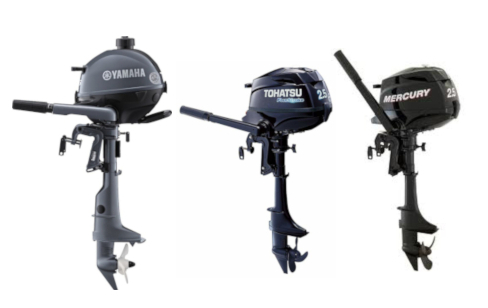 trio of small outboard motors